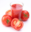 Fresh tomato juice and ripe tomatoes round glass.