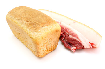Roll of fresh bread and the big piece of fat with meat