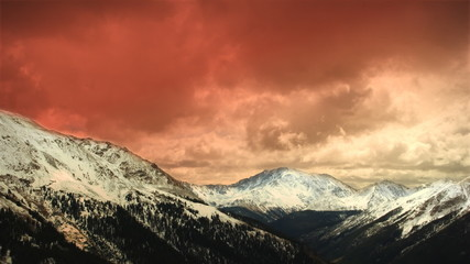 Early Winter Mountains Snow Sunset Clouds Skiing Aerial LOOP