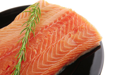 piece of salmon fillet and rosemary