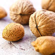 Walnuts and almonds on a stone background