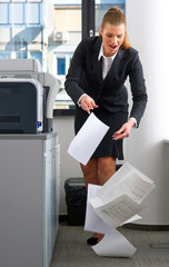 business woman dropping documents