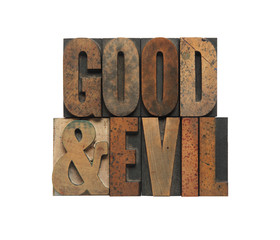 the words good and evil in old wood type