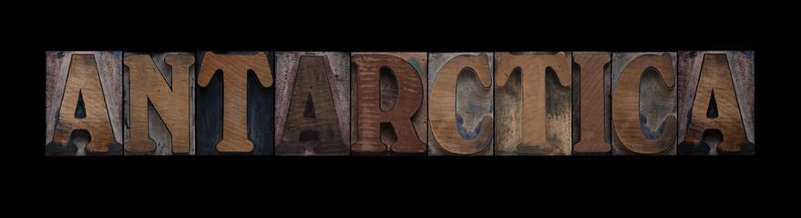 the word Antarctica in old letterpress wood type
