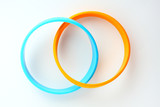 Yellow and light blue rubber bracelet.