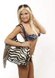 Beautful blond in swimwear with beach bag isolated poster