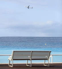 Promenade des Anglais in Nice, France (bench and an airplane)