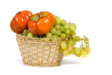 Ripe persimmons and grapes