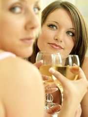 Two Young Women Drinking Wine. Models Released
