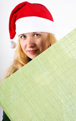 girl holding green board over a white background