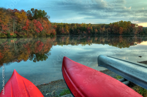 Colorful Canoes Moored By An Autumn Lake