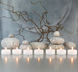 Leinwandbild Motiv Zweige, Steine, Kerzen