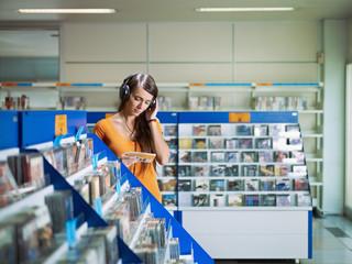 girl listening music in cd store