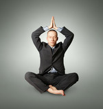 businessman in lotus pose meditating