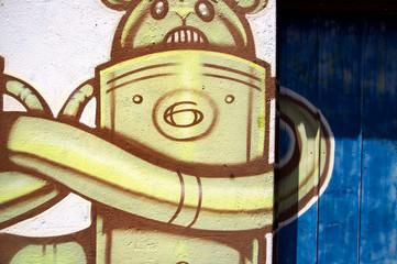 Modern style graffiti on brick wall.