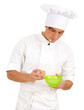man cook with broken egg above green bowl