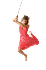 Young woman in jump with sword