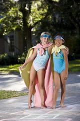 Make-believe, girls in homemade superhero costumes
