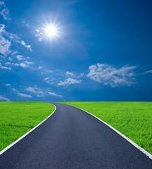 sport asphalt road among a green grass