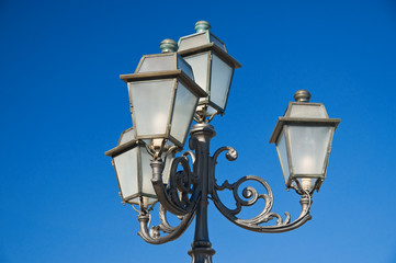 Street-lamp on blue sky.