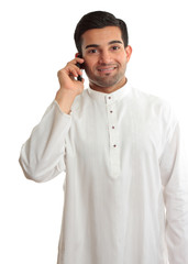 Smiling man using phone