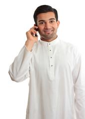 Smiling man using phone