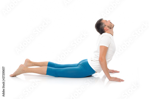 young man practising yoga postures combination cobra. isolated o