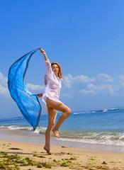 The young beautiful woman on an ocean coast. Indonesia. Bali.