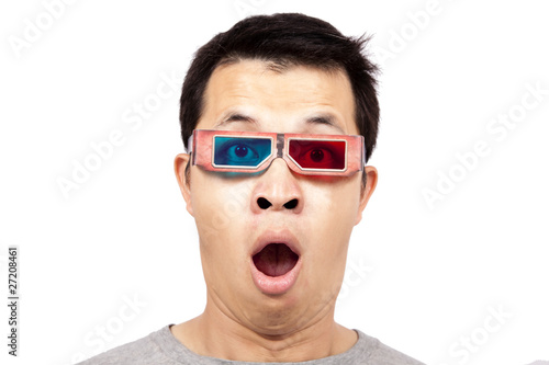 Young man with 3D glasses on watching a 3D movie .