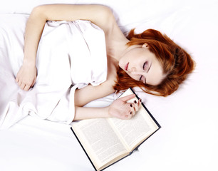 White nightie lying girl in the bed near book