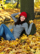 Beautiful woman spending time in park during autumn season