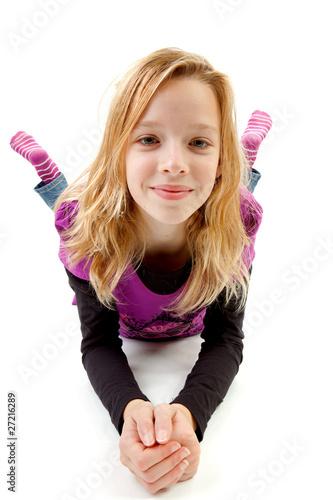 Leinwanddruck Bild Girl lie over white background over white background