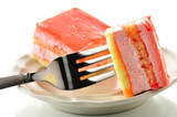 strawberry flavored layer cake with a fork