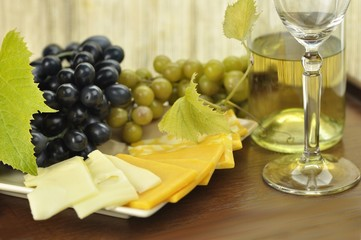 wine composition with cheese and grape close up