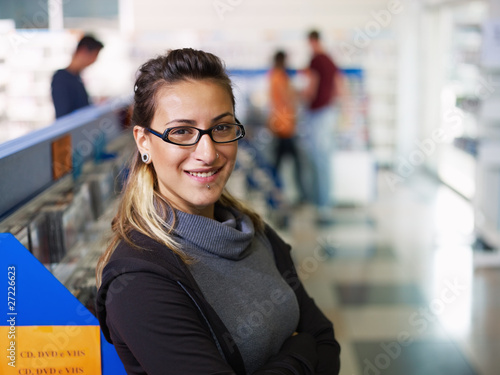 portrait of salesgirl in cd store