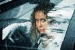 Woman and rain.