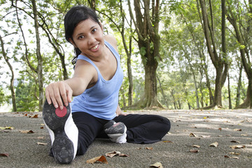 Woman performing stretching exercise