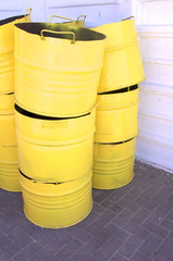 stack of yellow drums