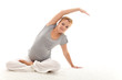 Beautiful pregnant woman doing stretching exercises