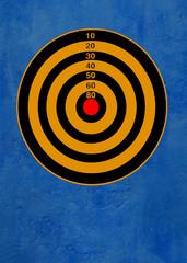 dartboard against blue wall .