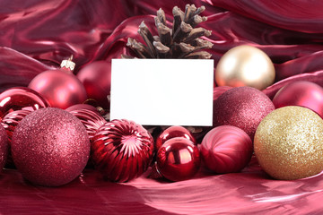 Christmas decorations with blank card over white background