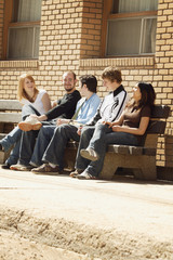 Friends Talking On A Bench