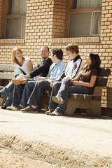 Friends Talking On A Bench