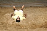 Man Lying On Beach