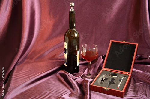 red wine, glass and corkscrew