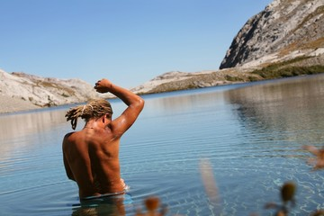Man Bathing In Mountain Lake