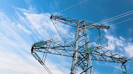 Electricity pylyn against blue cloudy sky