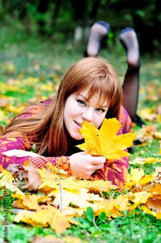 redheaded gril in autumn forest