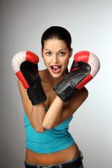 Young beautiful women wiht boxing gloves.