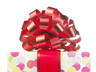 Gift with big red bow and ribbon